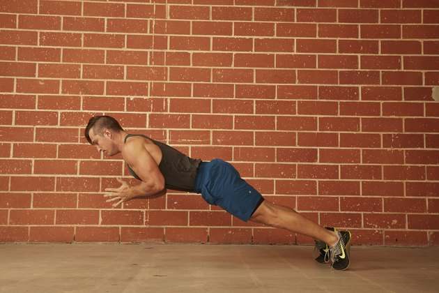 man demonstrating how to do a Clap Push-Up