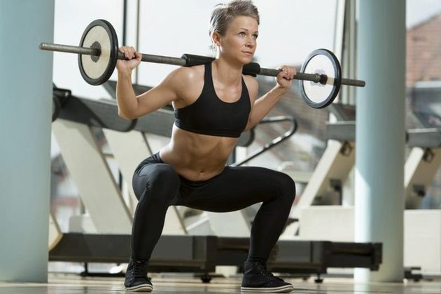 If your back hurts when you squat, you may be doing it wrong!