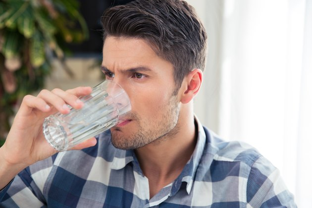 Bottoms up! Drinking lots of water helps your body flush out toxins.