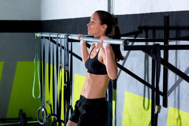 woman doing pull-up at CrossFit