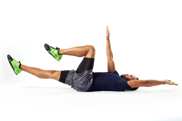 man doing a dead bug abdominal exercise