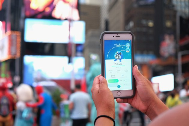 Someone checks their Poliwag stats in Times Square, New York City.