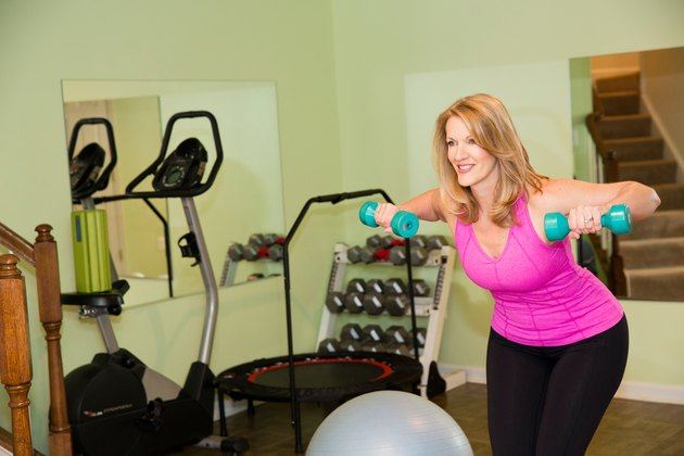 """I turned my basement into a small home gym with a secondhand bike, weights and a rebounder."""
