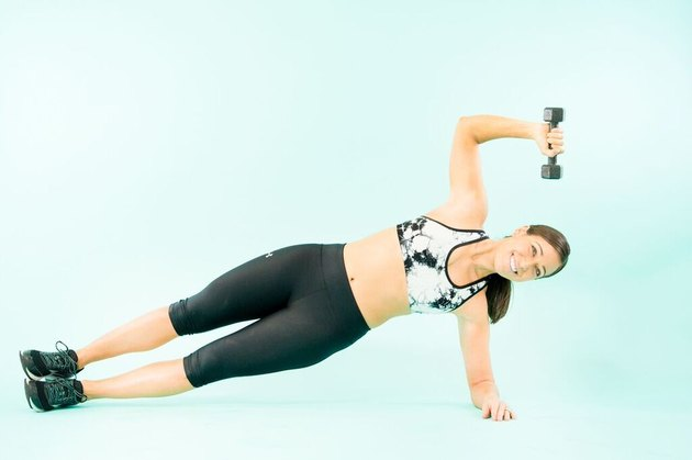 woman doing side plank triceps extensions