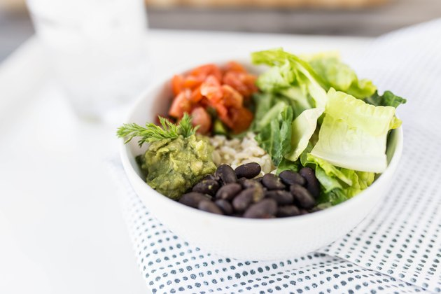 burrito bowl with beans, rice, salsa, lettuce and guacamole