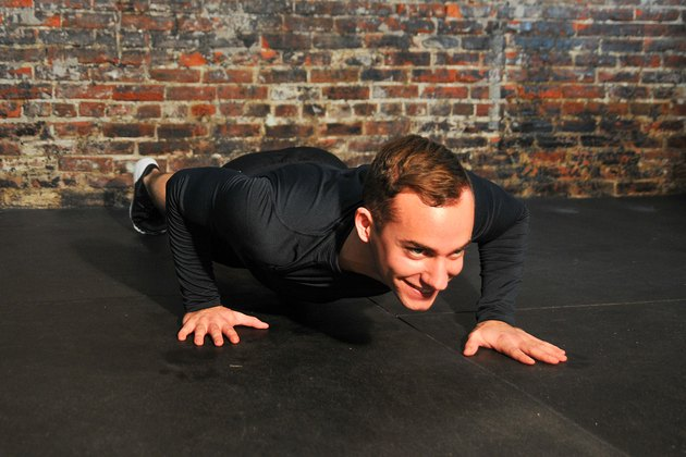 man doing a staggered push-up