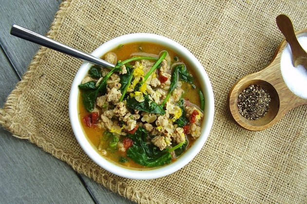A hot cereal bowl with oats and greens
