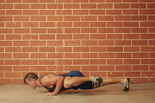 man demonstrating how to do a Knee-to-Elbow (Spiderman) Push-Up