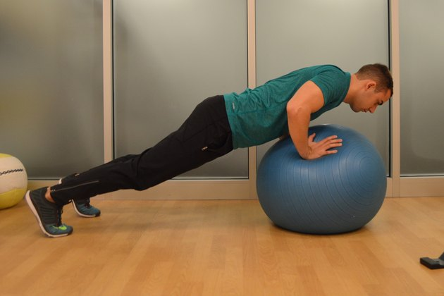 man doing a stability ball push-up