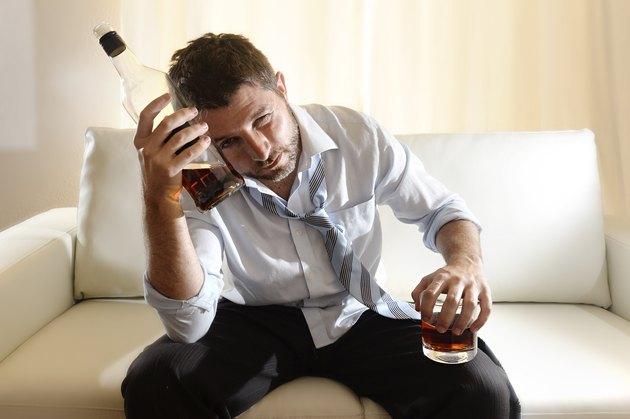 alcoholic man drinking alcohol