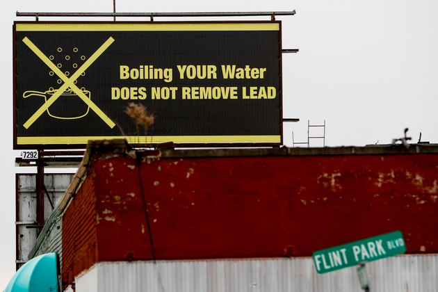 Flint, Michigan, billboard: Boiling your water does not remove lead