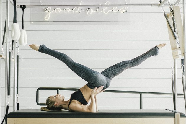 Woman performing flying scissors exercise.