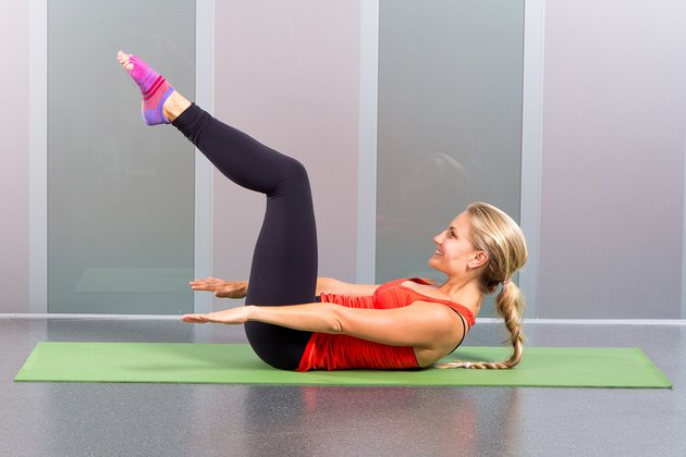 Woman working core with Pilates exercise