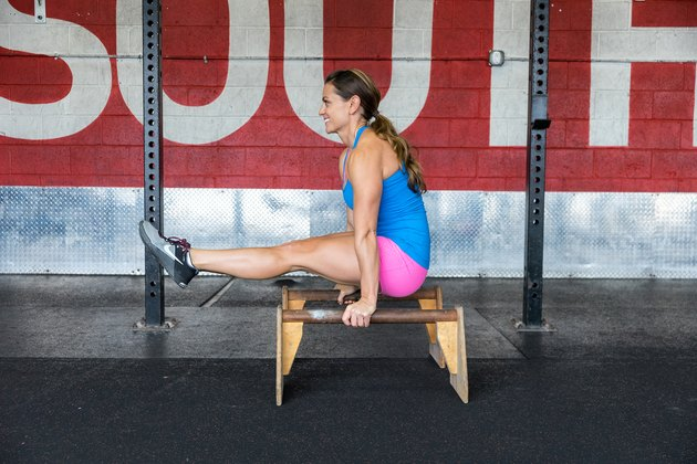 woman doing an L-sit crossfit exercise