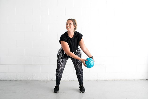 woman doing low squat chop standing ab exercise