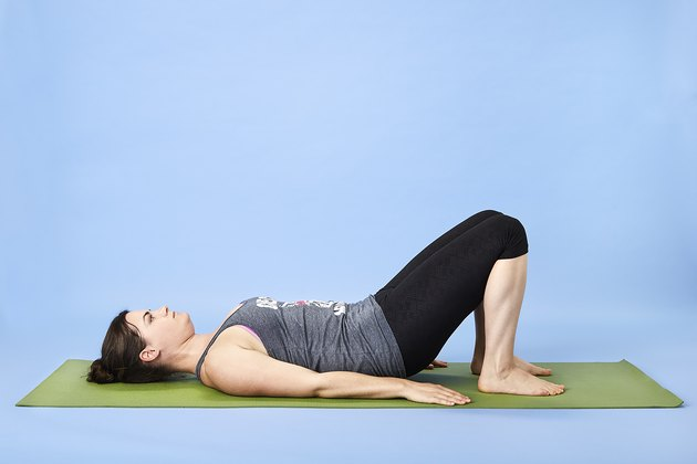 Woman performing core-strengthening pelvic tilts  for back pain