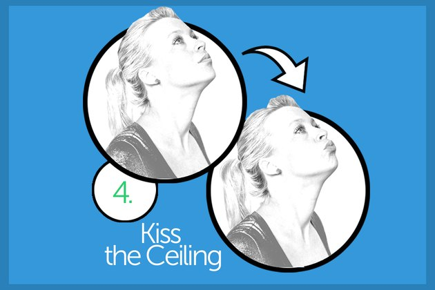 Woman performing kiss the ceiling exercise
