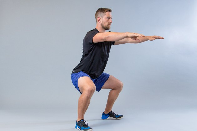 Man performing squat modification for knee pain