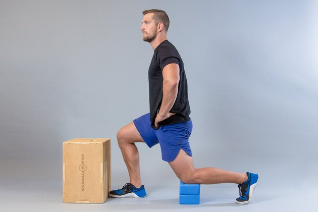Man performing lunge  modification for knee pain.