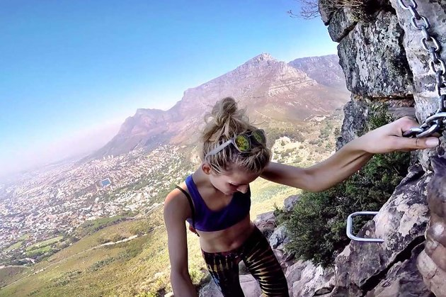 Woman free climbs up mountain in South Africa.