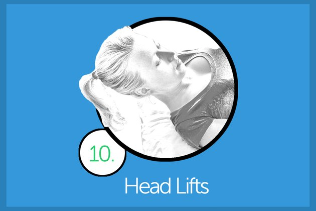 Woman performing head lift exercise.