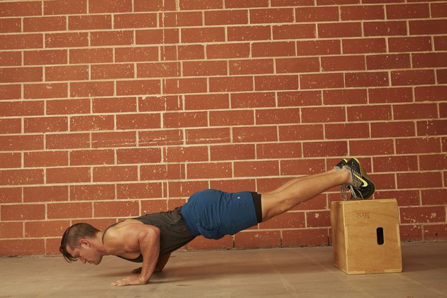 man demonstrating how to do a Decline Push-Up