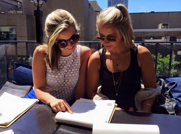 two women reading a menu