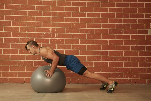 man demonstrating how to do a Stability Ball Push-Up