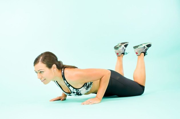 Woman performing modified push-ups.