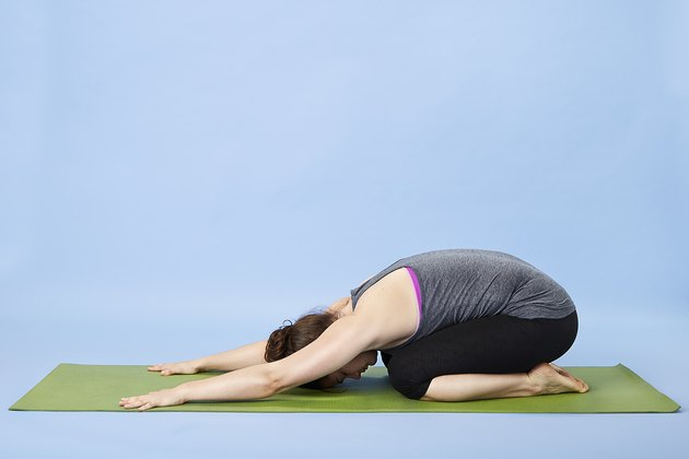 Woman performing Child's pose for back pain