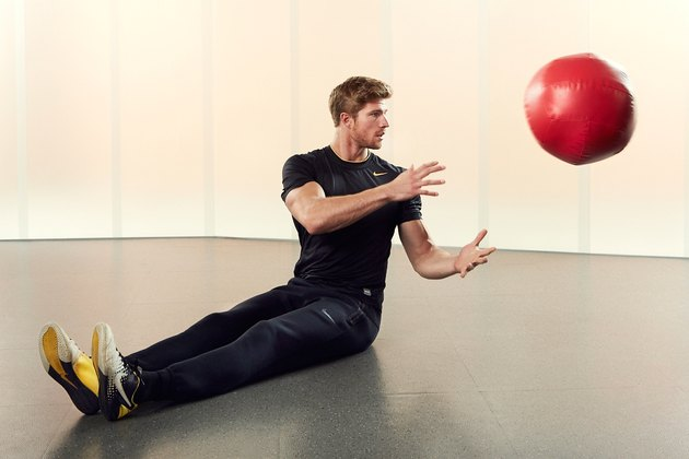 Man Demonstrating How to Do a Medicine Ball Lateral Scoop