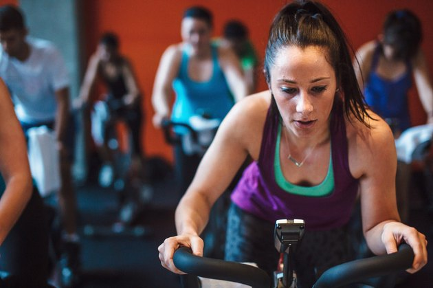 woman in indoor cycling class