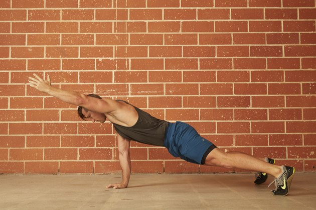 man demonstrating how to do a Single Arm Raise Push-Up