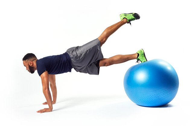 man doing hip extension flutters on a swiss exercise ball