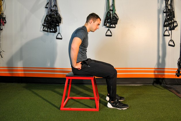 man doing a seated pelvic tilt