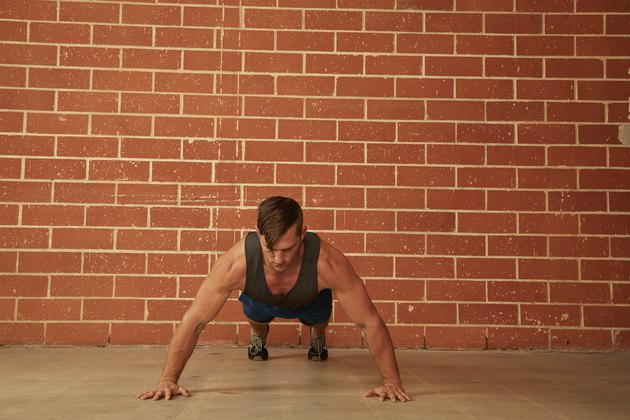man demonstrating how to do a Wide-Grip Push-Up