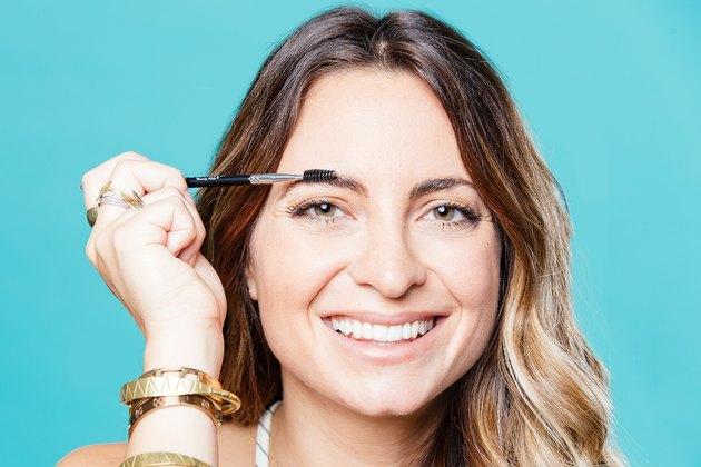 Jenna Gruttadauria blends her brow pencil and powder.