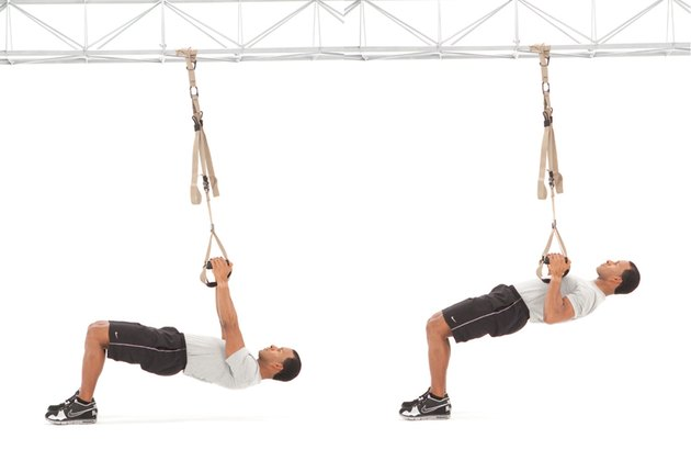 Man performing inverted row on the TRX Suspension Trainer