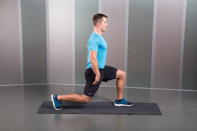 Man Demonstrating How to Do a Split-Squat Hold