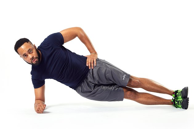 man holding a side plank