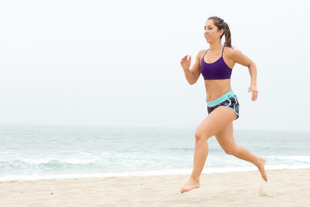 Woman Running/Sprinting During Her Beach Workout