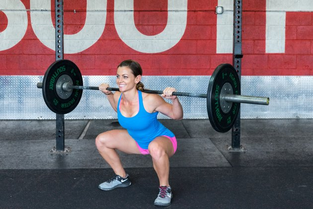 woman doing a back squat crossfit exercise