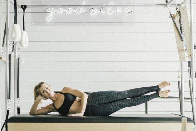 Woman performing dual leg lifts.