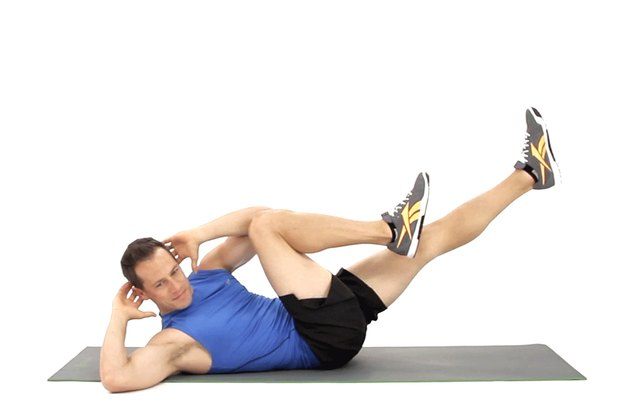 Man doing bicycle crunches to work his abs.