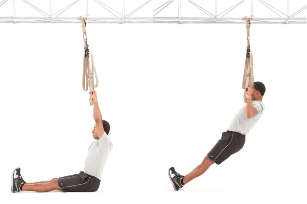 Man performing TRX pull-up on the TRX Suspension Trainer