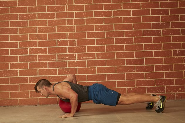 man demonstrating how to do a Medicine Ball Push-Up