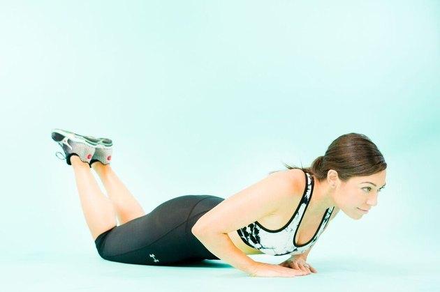 woman doing triangle push-ups