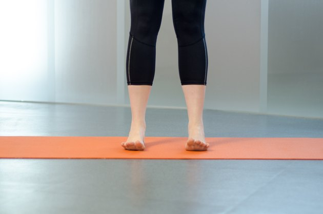 Woman performing toe spread and press for foot pain