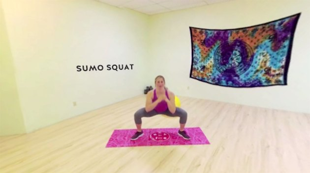 Fitness expert Jamie Lebowitz sumo squats in the Trinity Workout 360 video circuit.