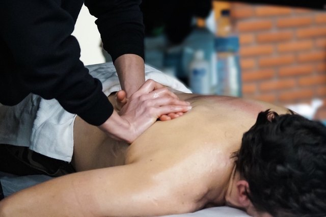 close up of a person receiving a massage